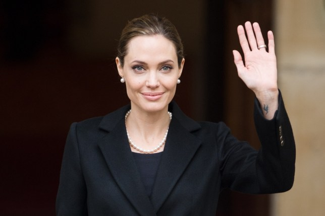 """(FILES) April 11, 2013 file photo shows US actress and humanitarian campaigner Angelina Jolie leaving Lancaster House in central London after speaking during an announcement of funding to address conflict sexual violence on the sidelines of the G8 Foreign Ministers meeting.  Angelina Jolie revealed May 14, 2013 that she has undergone a preventive double mastectomy to reduce her risk of cancer.  The American actress wrote in an opinion piece entitled """"My Medical Choice"""" in The New York Times that she had chosen the procedure because she carries a faulty gene that increases her risk of breast and ovarian cancer.   AFP PHOTO / LEON NEAL / FILESLEON NEAL/AFP/Getty Images"""