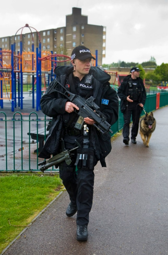 Armed police patrol the Marsh Farm estate in Luton after a spate of shootings