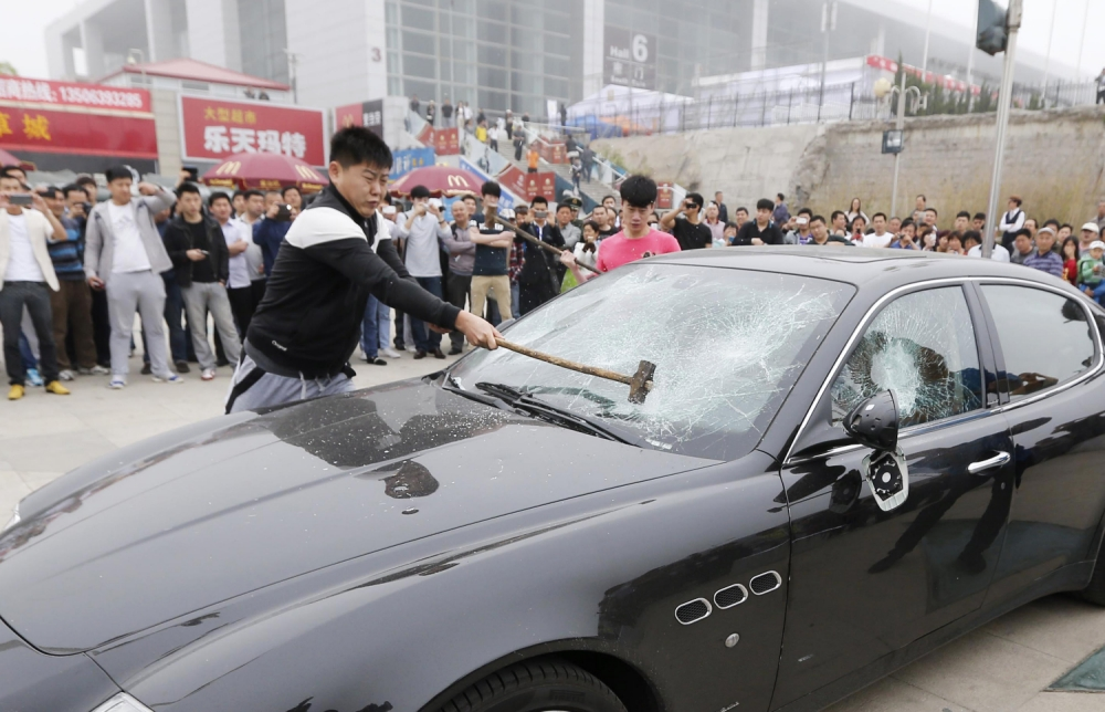 Angry Maserati owner hires men to sledgehammer his car