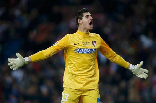 Atletico Madrid's goalkeeper Thibaut Courtois celebrates his team's second goal against Real Madrid during their Spanish King's Cup final soccer match at Santiago Bernabeu stadium in Madrid May 17, 2013.     REUTERS/Sergio Perez (SPAIN  - Tags: SPORT SOCCER)