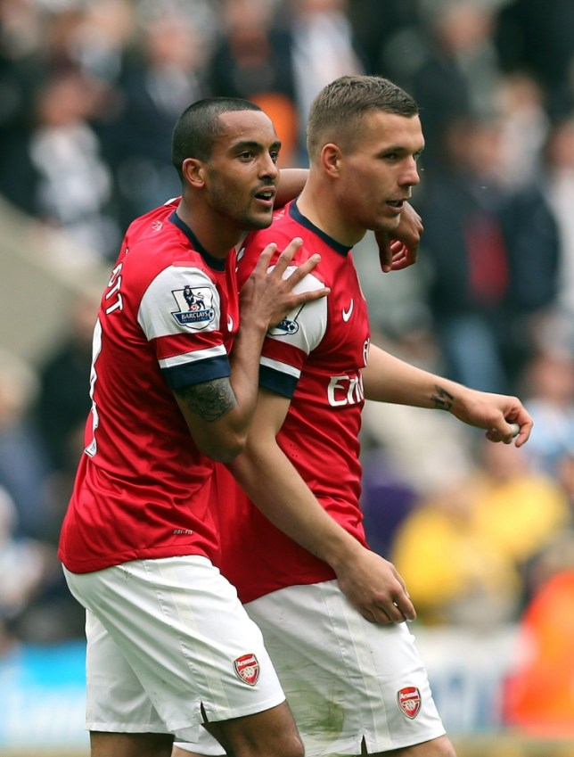 Arsenal's English midfielder Theo Walcott (L) and Arsenal's Polish-born German striker Lukas Podolski (R) celebrate their victory after the final whistle in the English Premier League football match between Newcastle United and Arsenal at St James' Park in Newcastle Upon Tyne, northeast England, on May 19, 2013. Arsenal won the race for fourth place in the Premier League with a 1-0 victory at Newcastle.  AFP PHOTO / IAN MACNICOL RESTRICTED TO EDITORIAL USE. No use with unauthorized audio, video, data, fixture lists, club/league logos or ìliveî services. Online in-match use limited to 45 images, no video emulation. No use in betting, games or single club/league/player publications.Ian MacNicol/AFP/Getty Images