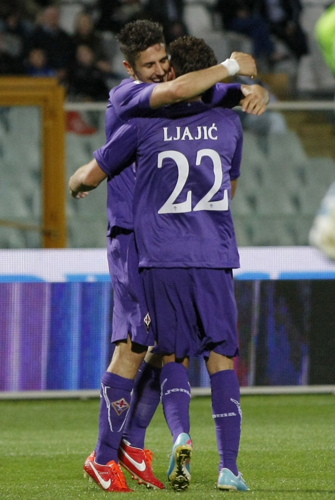Fiorentina's Montenegrin forward Stefan Jovetic (L) celebrates with teammate Serbian forward Adem Ljalic after scoring during the Italian Serie A football match Pescara Calcio vs ACF Fiorentina on May 19, 2013 at the Adriatico Stadium in Pescara.  AFP PHOTO / CARLO HERMANNCARLO HERMANN/AFP/Getty Images