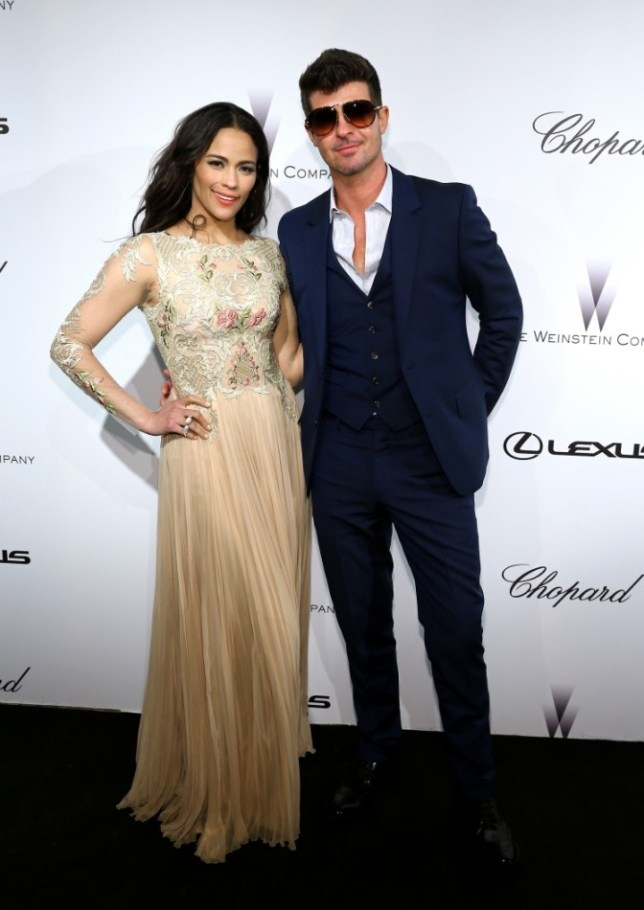 CANNES, FRANCE - MAY 19:  Actress Paula Patton and singer Robin Thicke attend The Weinstein Company Party in Cannes hosted by Lexus and Chopard at Baoli Beach on May 19, 2013 in Cannes, France.  (Photo by Neilson Barnard/Getty Images for The Weinstein Company)