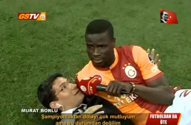 Inquisition: Emmanuel Eboue takes his turn on the mic (Picture: YouTube)