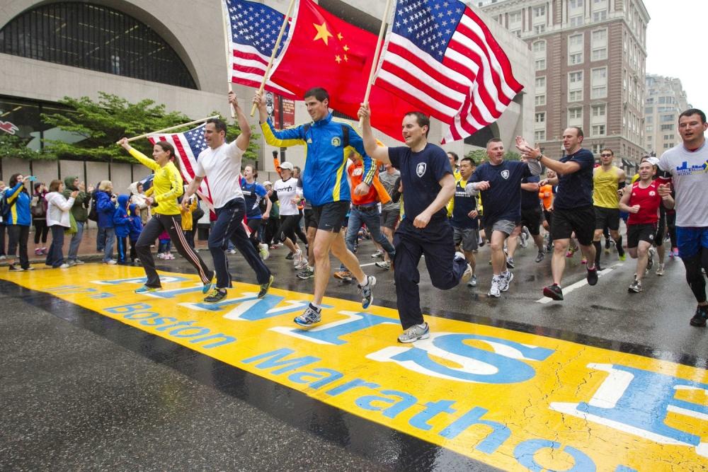 Victims of Boston marathon bombings finally complete last mile of the race