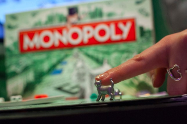 Monopoly's new token, the cat, is seen at Hasbro's New York office during Toy Fair 2013 in New York, February 11, 2013. After a month-long online vote in 185 countries, the iron was ousted by the cat, which became the newest token in the classic game after winning 31 percent of the vote. REUTERS/Andrew Kelly/Insider Images (UNITED STATES - Tags: SOCIETY) - RTR3DNRF