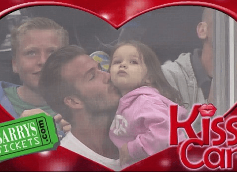 Daddy's little girl: Harper Beckham showered with kisses from dad David on KissCam during hockey game