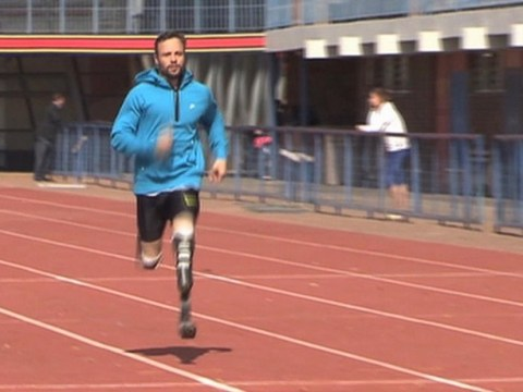 Oscar Pistorius pulls on his running blades for first time since shooting his girlfriend Reeva Steenkamp