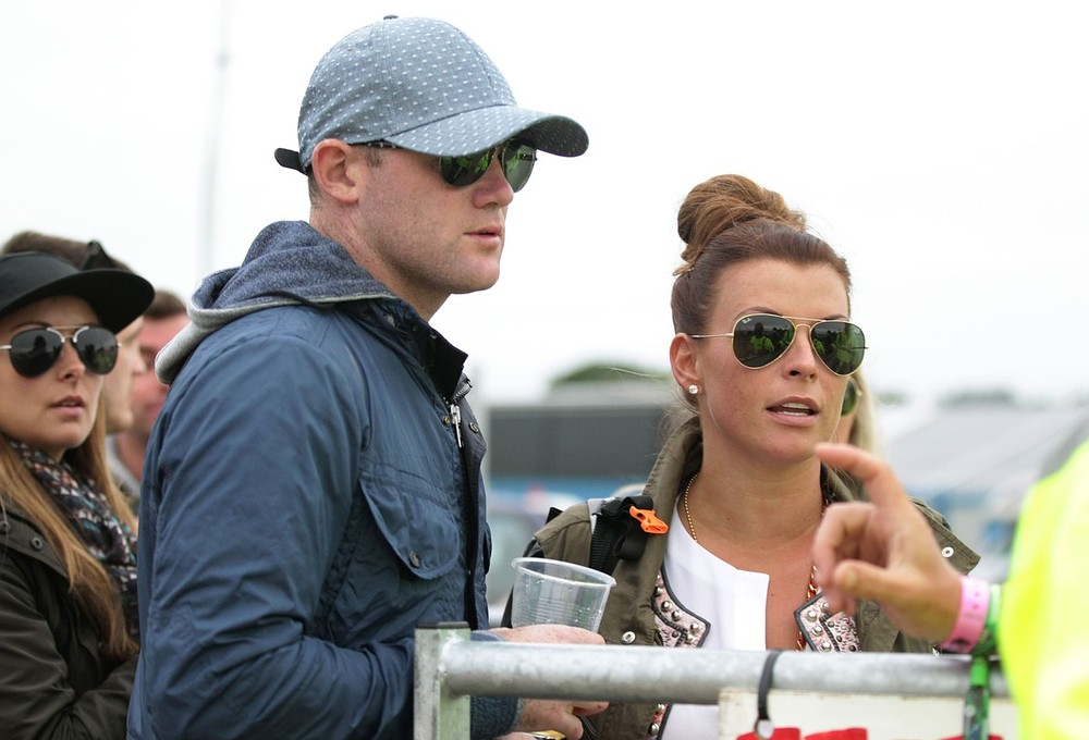 Wayne and Coleen Rooney are stopped at a backstage production gate leading to the Pyramid Stage during the first performance day of the Glastonbury 2013 Festival of Contemporary Performing Arts at Pilton Farm, Somerset. PA Wire/Press Association Images