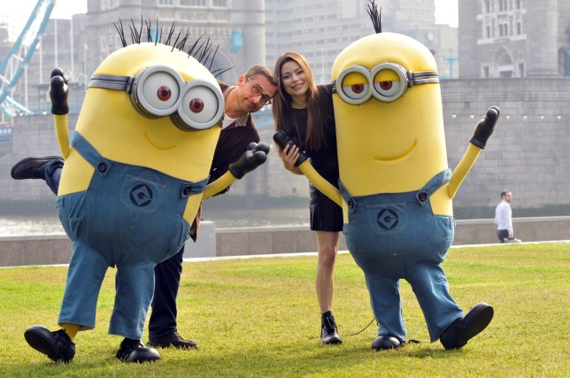 Steve Carell and Despicable Me 2 co-star Miranda Cosgrove pose with some Minions in London (Picture: AP)