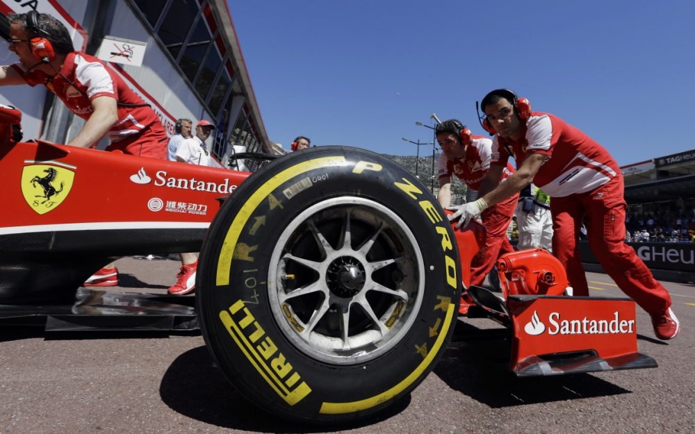 Ferrari driver Fernando Alonso of Spain gets a pit service during the first free practice at the Monaco racetrack, in Monaco, Thursday, May 23, 2013. Closing in on Formula One leader Sebastian Vettel, Ferrari driver Fernando Alonso suggested Wednesday that Red Bull's complaints about Pirelli's fast-degrading tires are due to frustration at no longer dominating races. The Formula one race will be held on Sunday. (AP Photo/Luca Bruno)