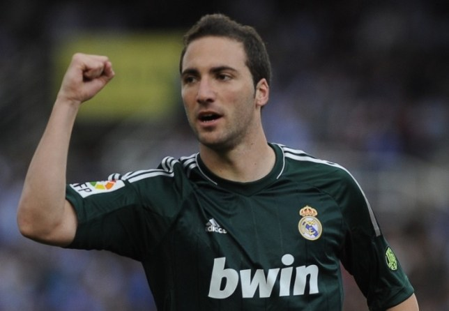 Real Madrid's Argentinian forward Gonzalo Higuain celebrates after scoring during the Spanish league football match Real Sociedad vs Real Madrid at Anoeta stadium in San Sebastian on May 26, 2013.  AFP PHOTO/ RAFA RIVASRAFA RIVAS/AFP/Getty Images
