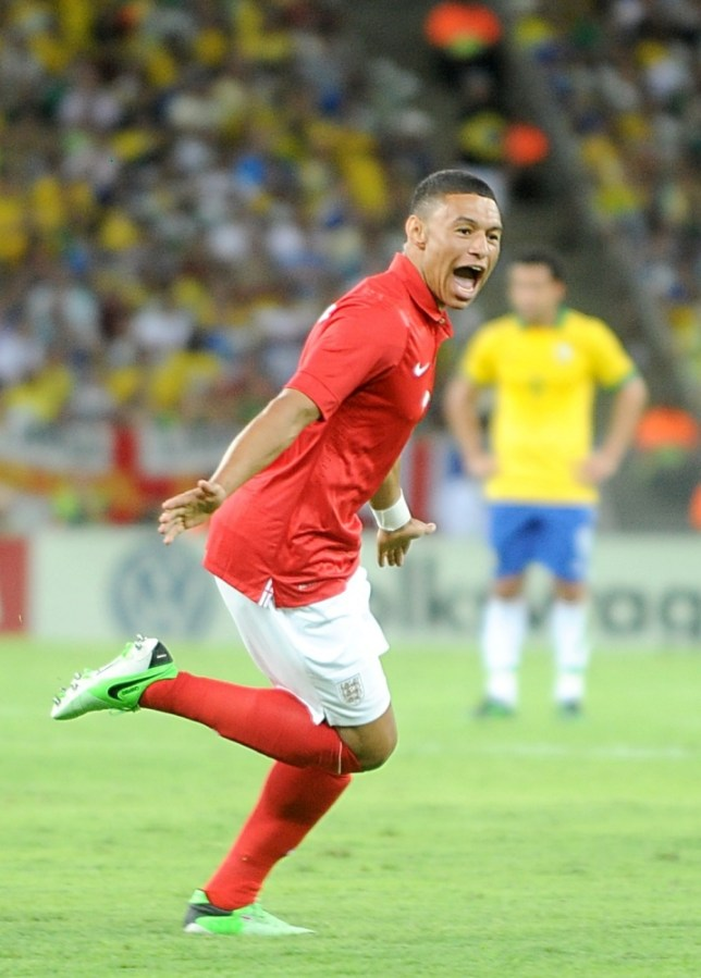 England's Alex Oxlade-Chamberlain celebrates scoring their first goal of the game during the International Friendly at the Maracana Stadium in Rio De Janeiro, Brazil. PRESS ASSOCIATION Photo. Picture date: Sunday June 2, 2013. See PA story SOCCER England. Photo credit should read: Owen Humphreys/PA Wire. RESTRICTIONS: Use subject to FA restrictions. Editorial use only. Commercial use only with prior written consent of the FA. No editing except cropping. Call +44 (0)1158 447447 or see www.paphotos.com/info/ for full restrictions and further information.