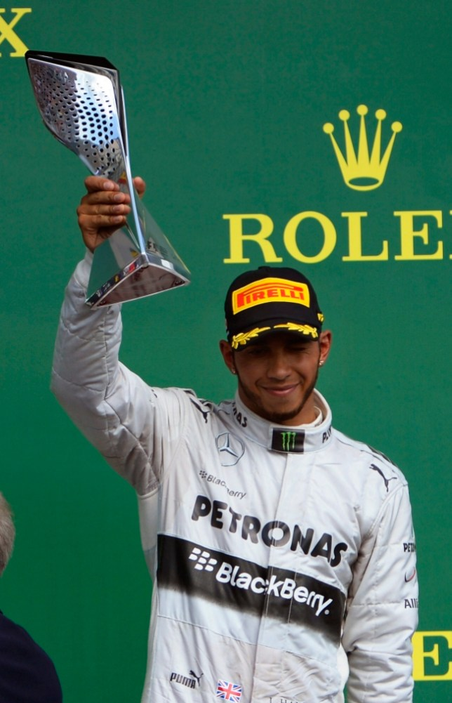 epa03738145 British Formula One driver Lewis Hamilton of Mercedes AMG celebrates on the podium after taking the third place in the 2013 Canada Formula One Grand Prix at Gille Villeneuve circuit in Montreal, Canada, 09 June 2013.  EPA/CJ GUNTHER
