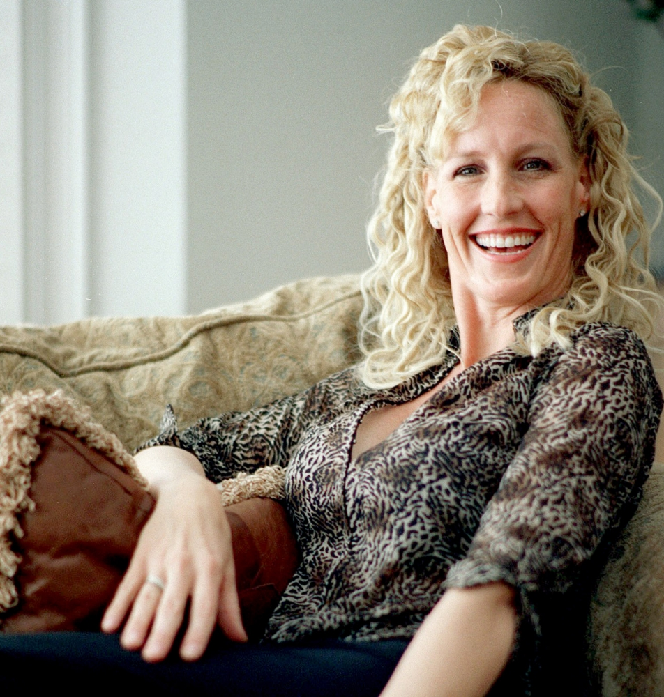 FILE - In this  March 24, 2000, file photo, environmental activist Erin Brockovich sits in her home in Agoura Hills, Calif.  Brockovich has been arrested on suspicion of boating while intoxicated at Lake Mead near Las Vegas, authorities said Sunday, June 9, 2013. Brockovich was arrested late Friday night after breath tests showed her blood-alcohol level was over the legal limit, said a spokesman for the Nevada Department of Wildlife. (AP Photo/Damian Dovarganes, File)