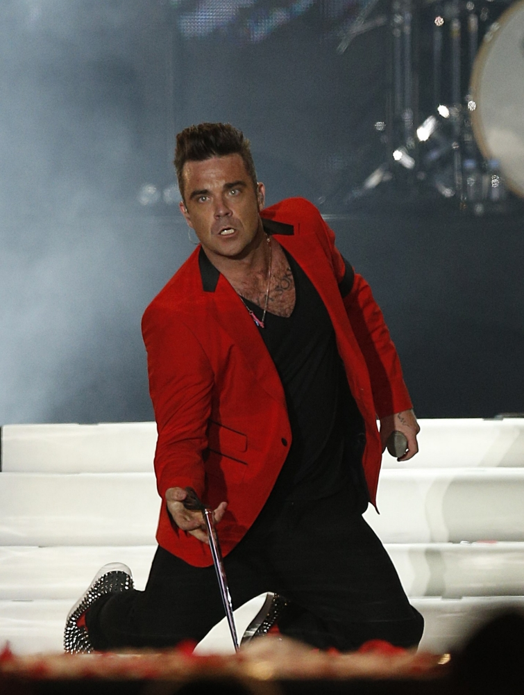 Robbie Williams onstage at the Capital FM Summertime Ball at Wembley in London. (Picture: PA)