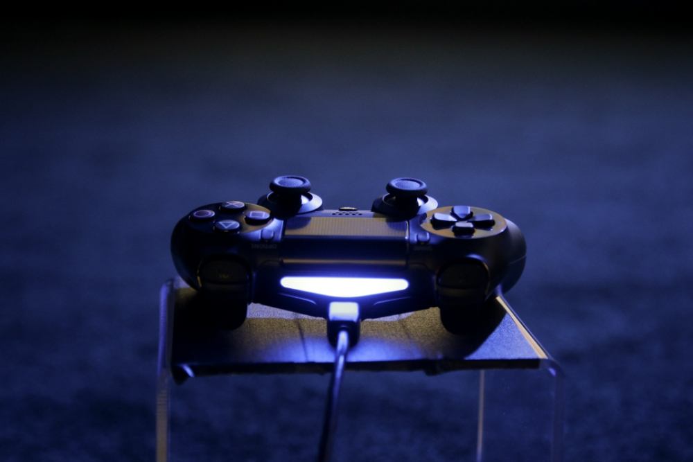 A controller for the new PlayStation 4 is on display at the Sony PlayStation E3 media briefing in Los Angeles, Monday, June 10, 2013. Sony is giving gamers their first look at the PlayStation 4 and it's a rectangular black box, just like all the previous PlayStations. (AP Photo/Jae C. Hong)