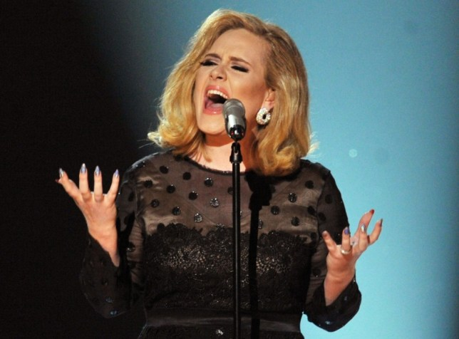 FILE - JUNE 15: Queen's Birthday Honours list - Famous names among the 1,180 people who have been recognised in the Queen's Birthday Honours list, including an MBE for singer Adele and honours for the Blackadder actors Tony Robinson (Knighthood) and Rowan Atkinson (CBE).  LOS ANGELES, CA - FEBRUARY 12:  Singer Adele performs onstage at the 54th Annual GRAMMY Awards held at Staples Center on February 12, 2012 in Los Angeles, California.  (Photo by Kevin Winter/Getty Images)