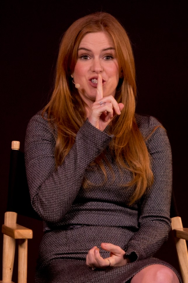 """Actress Isla Fisher gestures as she discusses her new film 'Now You See Me', at the Apple store in central London, Wednesday, June 19, 2013. The film follows """"The Four Horsemen"""", a super-team of the world's greatest illusionists who pull off a series of daring heists against corrupt business leaders.(Photo by Joel Ryan/Invision/AP)"""