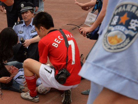 Five people injured during stampede to see David Beckham in China