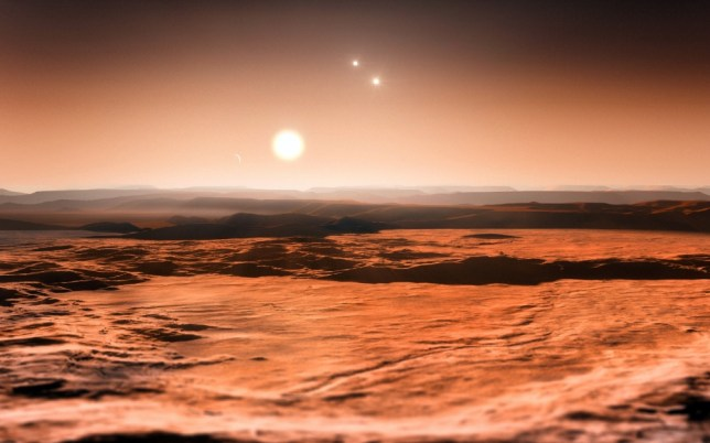 """EMBARGOED UNTIL 25 JUNE 2013, 12:00 CEST A handout photo provided on June 24, 2013 by the European Southern Observatory (ESO) shows an artists impression of the view from the exoplanet Gliese 667Cd looking towards the planets parent star (Gliese 667C). In the background to the right, the more distant stars in this triple system (Gliese 667A and Gliese 667B) are visible and to the left in the sky one of the other planets, the newly discovered Gliese 667Ce, can be seen as a crescent. A record-breaking three planets in this system are super-Earths lying in the zone around the star where liquid water could exist, making them possible candidates for the presence of life. This is the first system found with a fully packed habitable zone. AFP PHOTO / ESO / M. KORNMESSER RESTRICTED TO EDITORIAL USE - MANDATORY CREDIT """"AFP PHOTO / ESO / M. KORNMESSER"""" - NO MARKETING NO ADVERTISING CAMPAIGNS - DISTRIBUTED AS A SERVICE TO CLIENTSM. KORNMESSER/AFP/Getty Images"""
