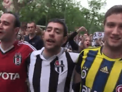 Turkish football fans put aside bitter rivalry and join demonstrators