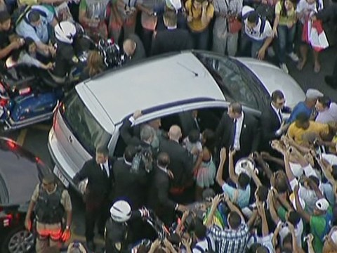 Pope mobbed by well-wishers in Rio de Janeiro after his car takes a wrong turning