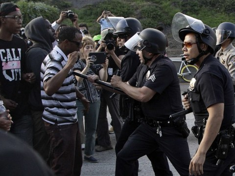 Trayvon Martin protesters clash with police as anger mounts at George Zimmerman's acquittal