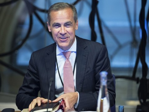 New 'George Clooney' Bank of England governor takes the Tube to work on his first day
