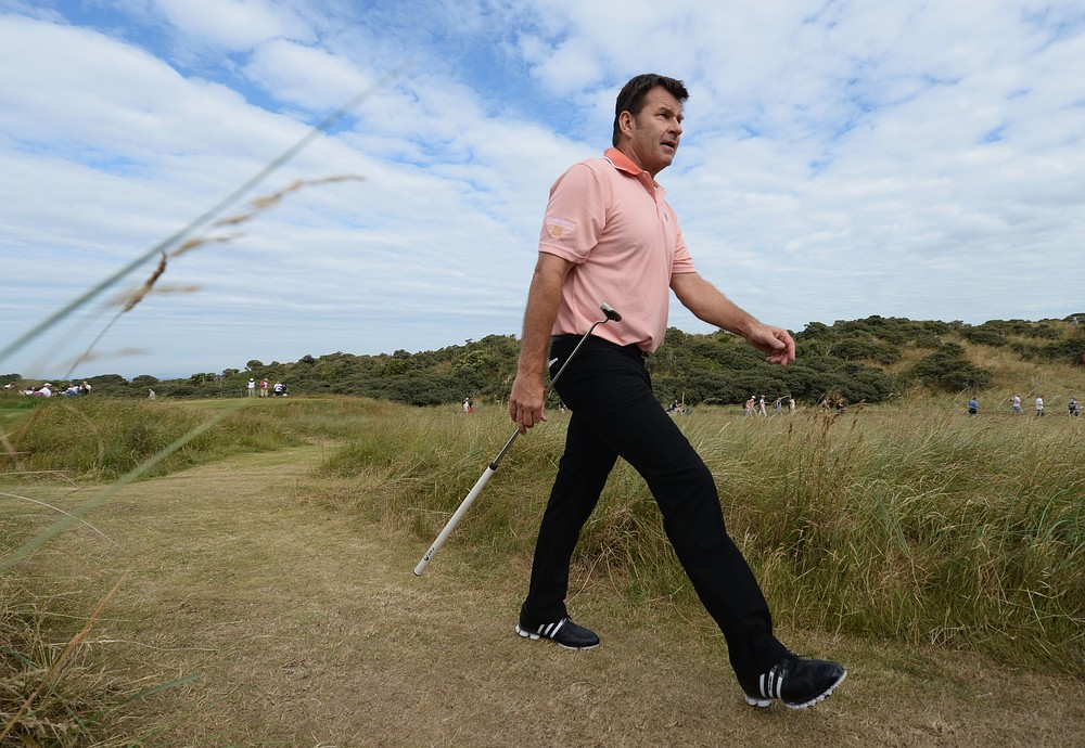 The Open 2013: Sir Nick Faldo's plan to wear special jumper is scuppered by heatwave