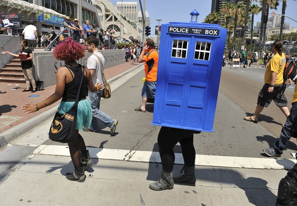 An attendee dressed as a police public call box crosses the street on Day 2 of Comic-Con International on Thursday, July 18, 2013 in San Diego, Calif. Chris Pizzello/Invision/AP