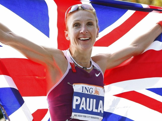 Britain 's Paula Radcliffe holds the Union Jack after winning the Women's division of the 2008 New York City Marathon in New York in this November 2, 2008 file photo. World marathon record holder Paula Radcliffe has been pulled out of the marathon race at the London Olympics for medical reasons, the British Olympic Association and UK Athletics announced on Sunday. REUTERS