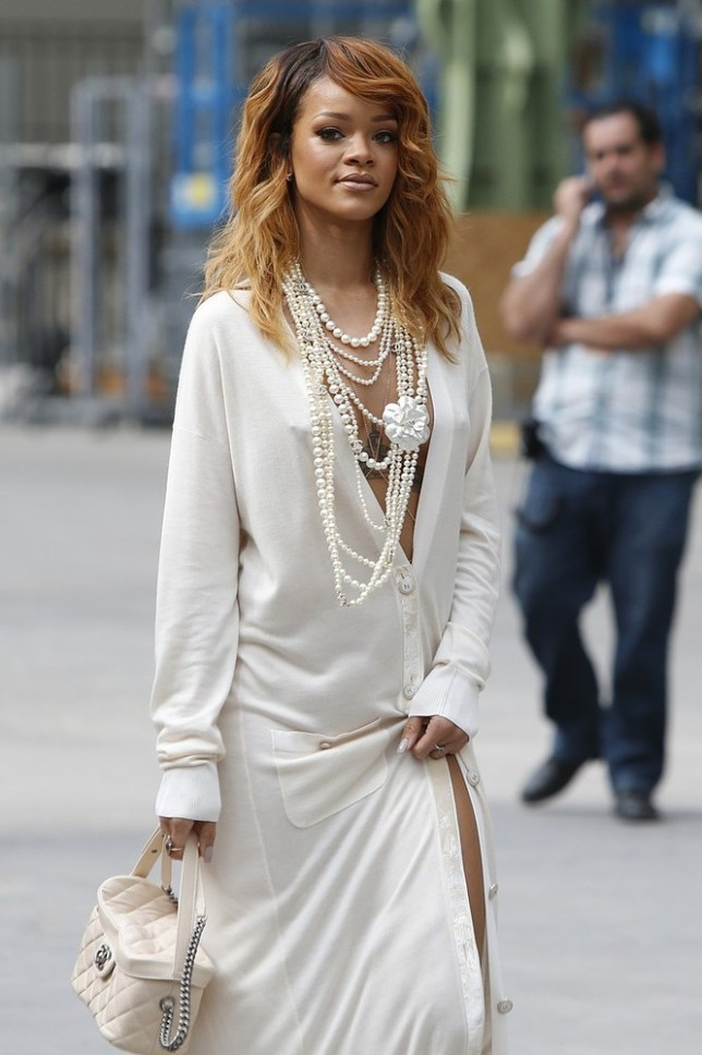 Singer Rihanna arrives to pose for photographers prior to attending Chanel's Haute Couture Fall-Winter 2013-2014 collection, presented Tuesday, July 2, 2013 in Paris. AP