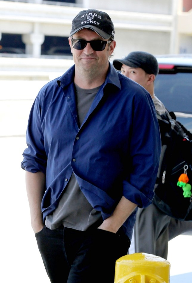 27.JUNE.2013 - LOS ANGELES - USA ACTOR MATTHEW PERRY IS ALL SMILES WHILE LEAVING LOS ANGELES INTERNATIONAL AIRPORT AND ON HIS WAY TO MUNICH. BYLINE MUST READ : XPOSUREPHOTOS.COM *AVAILABLE FOR UK SALE ONLY* ***UK CLIENTS - PICTURES CONTAINING CHILDREN PLEASE PIXELATE FACE PRIOR TO PUBLICATION *** *THIS IMAGE IS STRICTLY FOR PAPER AND MAGAZINE USE ONLY - NO WEB ALLOWED USAGE UNLESS PREVIOUSLY AGREED. **UK CLIENTS MUST CALL PRIOR TO TV OR ONLINE USAGE PLEASE TELEPHONE 44 208 370 0291**