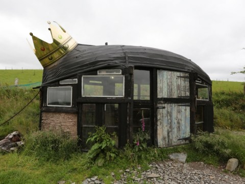 Eco-friendly retreat with boat for a roof crowned shed of the year