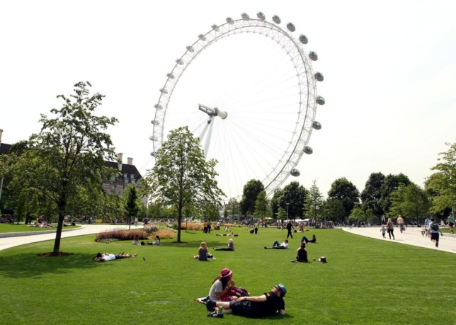 People enjoying the hot Weather by the London Eye on the Southbank in London. PRESS ASSOCIATION Photo. Picture date: Friday July 5, 2013. Britain is expected to bask in the hottest temperatures of the year this weekend as the country prepares for a long spell of sweltering summer weather. See PA story WEATHER Hot. Photo credit should read: Sean Dempsey/PA Wire