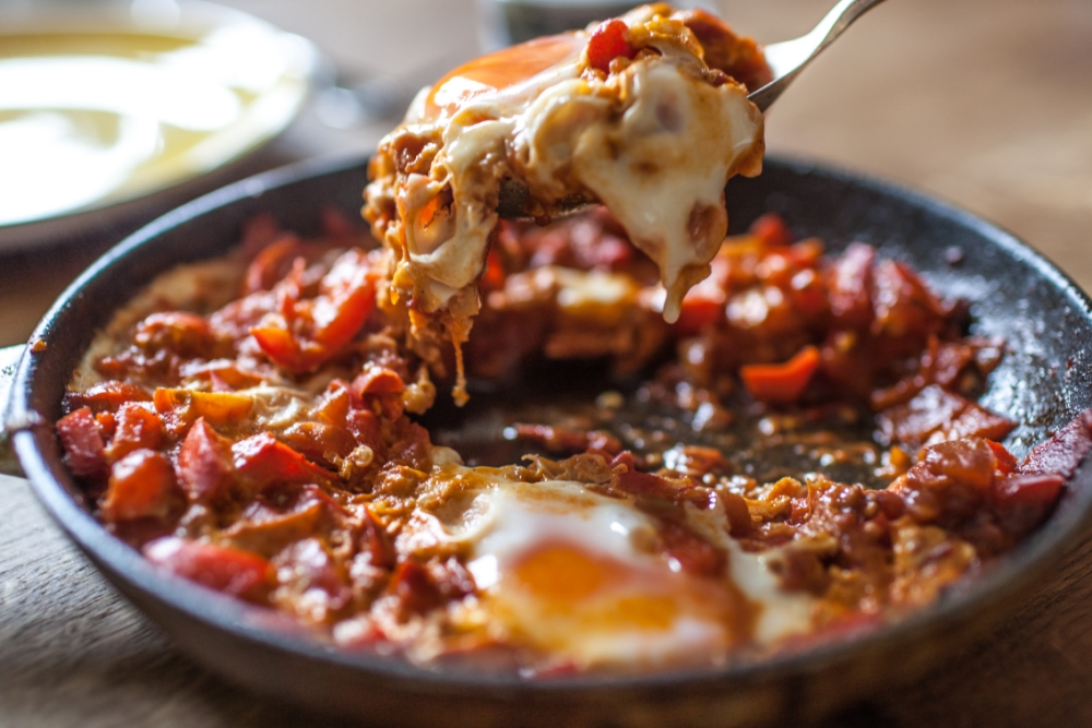Shakshuka combines ruby red tomatoes with poached eggs and is great for breakfast (Picture: Oli Jones)