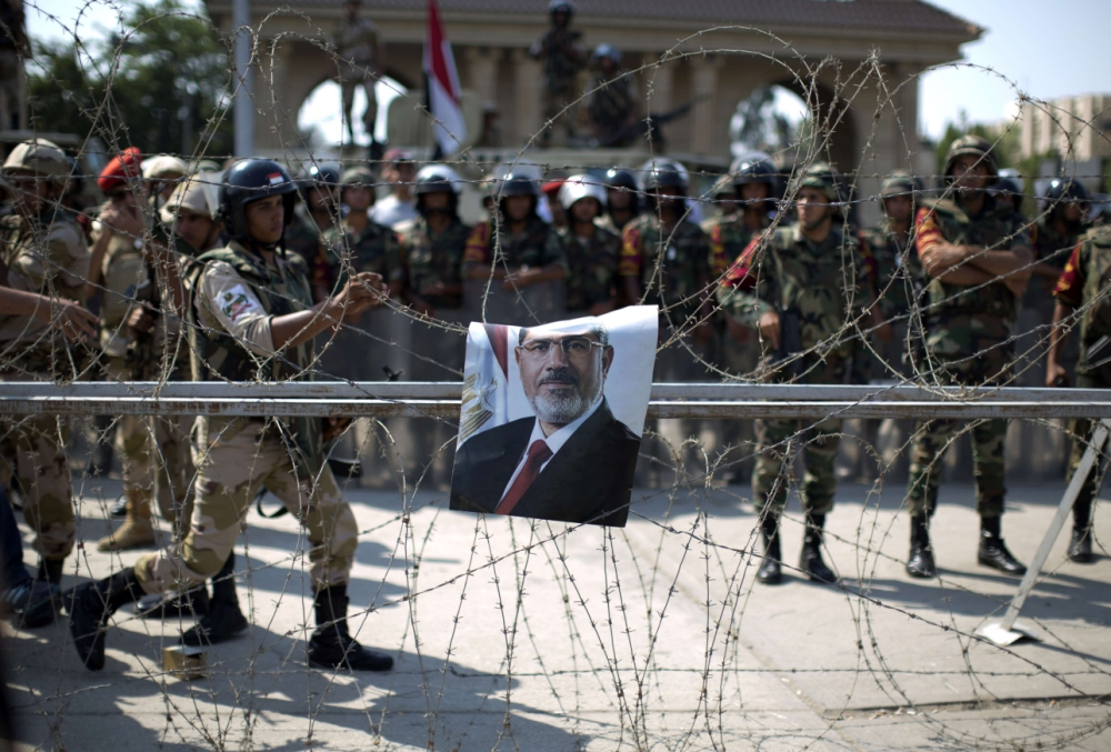 Egypt: Protesters killed in clashes between army and Mohammed Morsi supporters