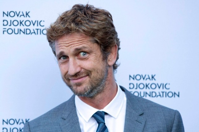 Actor Gerard Butler poses for photographers as he arrives at a fundraising dinner for the Novak Djokovic Foundation in London July 8, 2013.   REUTERS/Neil Hall   (BRITAIN - Tags: SPORT TENNIS ENTERTAINMENT SOCIETY HEADSHOT PROFILE)