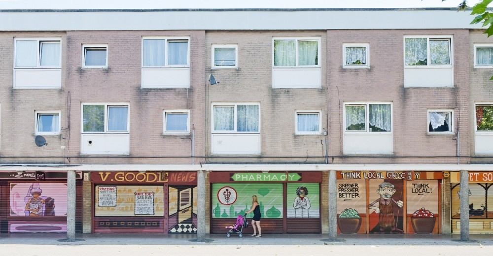 A rundown estate in Southampton has been given a new lease of life. Local pupils and artists worked together to recreate old-fashioned shopfronts from the 1960s (Picture: Jamie Lorriman/Solent News)