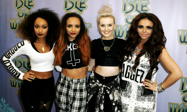 FILE - In this June 15, 2013 file photo, from left, Liegh-Anne Pinnock, Jade Thirlwall, Perrie Edwards and Jesy Nelson of Little Mix pose for photographers at the Isle of Wight Festival in Newport on the Isle of Wight.  Little Mix is one of a new crop of girl groups currently on the music scene. (Photo by Jim Ross/Invision/AP, File)