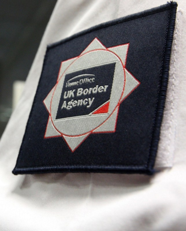 """Embargoed to 0001 SaturdayJuly 13. File photo dated 23/11/09 of a badge on UK Border Agency officer's uniform as a group of MPs has  warned that a backlog of immigration cases at Britain's troubled border service has hit a """"staggering"""" half a million people and at the current rate of progress will take nearly four decades to clear. PRESS ASSOCIATION Photo. Issue date: Saturday July 13, 2013. A rise in the number of foreign-national offenders living in the community as they await deportation was also discovered by the Home Affairs Select Committee in its latest report into the work of the now-defunct UK Border Agency (UKBA). See PA story POLITICS Borders. Photo credit should read: Steve Parsons/PA Wire"""