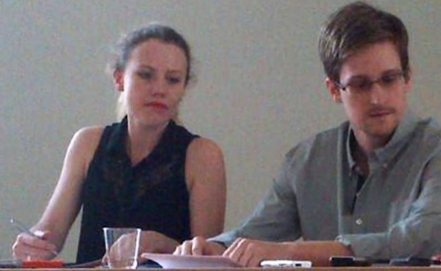 Edward Snowden speaking at a meeting in a Moscow airport. To the left is Sarah Harrison, a representative of Wikileaks (Picture: Human Rights Watch/Reuters)