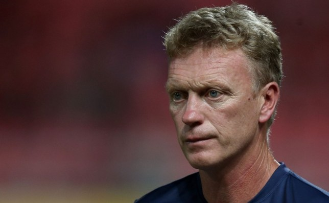 BANGKOK, THAILAND - JULY 13:  of Manchester United manager David Moyes  watches on after the friendly match between Singha All Star XI and Manchester United at Rajamangala Stadium on July 13, 2013 in Bangkok, Thailand.  (Photo by Chris McGrath/Getty Images)