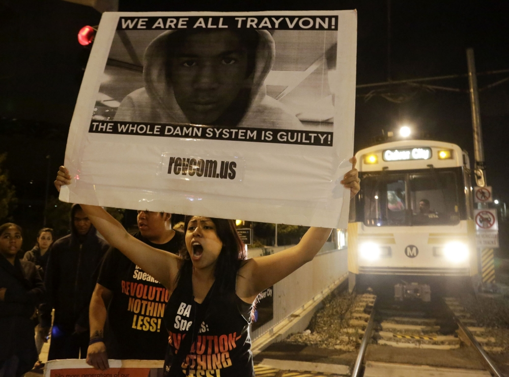 Protests erupt across America as Trayvon Martin 'vigilante' killer George Zimmerman walks free
