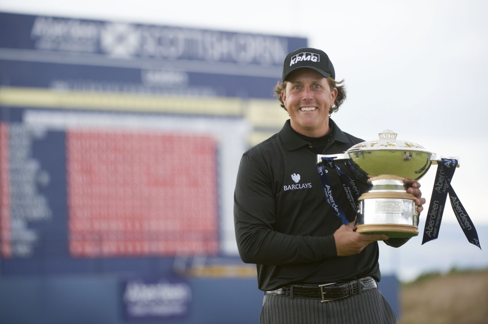 Phil Mickelson celebrates with the trophy after winning the Aberdeen Asset Management Scottish Open at Castle Stuart Golf Course, Inverness. PRESS ASSOCIATION Photo. Picture date: Sunday July 14, 2013. Photo credit should read: Kenny Smith/PA Wire. RESTRICTIONS: Use subject to restrictions. Editorial use only. No commercial use. Call +44 (0)1158 447447 for further information.