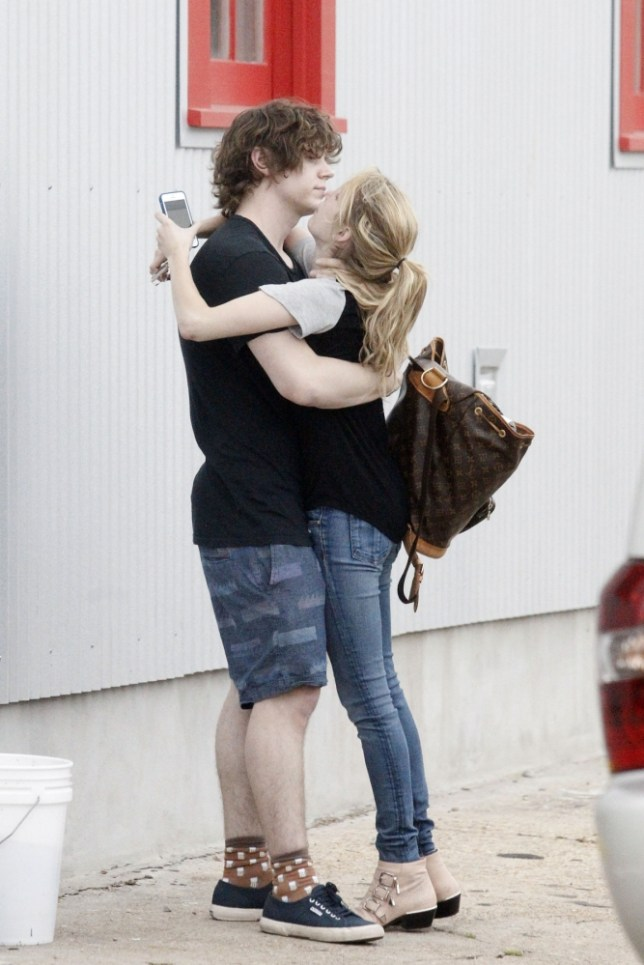 "100961, **EXCLUSIVE** NEW ORLEANS, LOUISIANA - Tuesday July 16, 2013. A distraught Emma Roberts is comforted by boyfriend Evan Peters after arriving in New Orleans, as news broke of her arrest for domestic violence against Peters. Roberts met with Peters at a studio, where she chatted on a phone and soon began crying. Peters tried comforting her with a hug, with the two eventually going into the studio together. The domestic violence incident, occurring on July 7th, took place at a Montreal hotel when someone called police to report a fight in a hotel room. Law enforcement arrived to find Peters with a bloody nose and possible bite mark, prompting the arrest of Emma. She was released a few hours later after Peter's refused to press charges. The couple, still together, will be filming the 3rd season of ""Amn Horror rror Story"" in the upcoming weeks. Photograph: © PacificCoastNews.com **FEE MUST BE AGREED PRIOR TO USAGE** **E-TABLET/IPAD & MOBILE PHONE APP PUBLISHING REQUIRES ADDITIONAL FEES** LOS ANGELES OFFICE: +1 310 822 0419 LONDON OFFICE: +44 20 8090 4079"