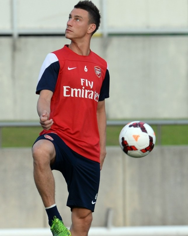 Arsenal defender Laurent Koscielny plays with a ball during their training session in Nagoya on July 21, 2013. Arsenal's Japanese leg of their pre-season Asian tour is a trip down memory lane for Arsene Wenger, as he faces former club Nagoya Grampus -- coached by one of his ex-players.         AFP PHOTO / TOSHIFUMI KITAMURATOSHIFUMI KITAMURA/AFP/Getty Images