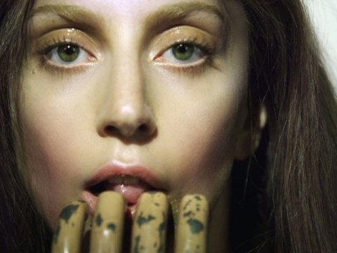 Lady Gaga shocks by licking dirty fingers to tease comeback