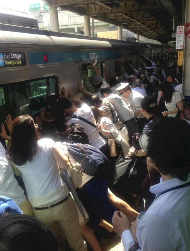 Dozens of commuters help free woman trapped under train in Japan